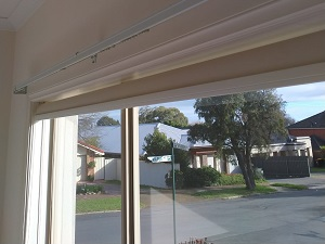 Curtain rails and blind